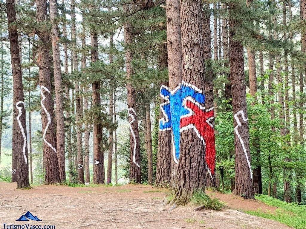 personas en el bosque pintado de oma